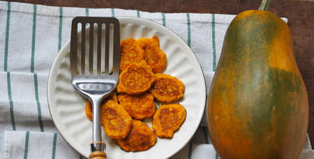 Pumpkin and millet pancakes. Russian national cuisine, healthy breakfasts. Popular in kindergartens, good for toddlers and older people. Authentic Russian still life.