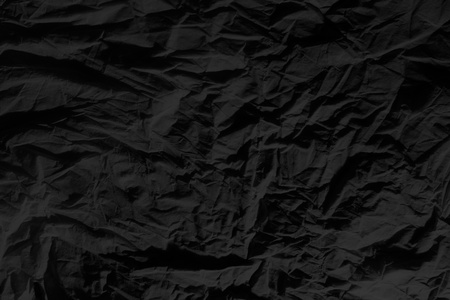 wrinkled paper: black paper background