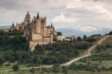 Alcazar castle in Segovia with Pealara mountain. Castilla y Leon, Spain
