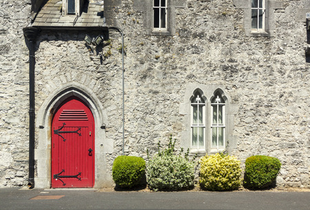 The Abbey of Adare. Detail door, windows and vegetation. In the county of Limerick, Ireland Stock Photo