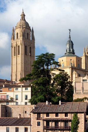 Mirador de Segovia with gothic cathedral, typical old houses, city wall. Trees, pinnacles and tower. Segovia, Spain