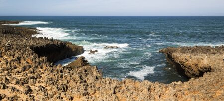 Fishermen's route in the Alentejo, promenade with cliffs in Portugal. Wooden walkway along the coastline. 写真素材