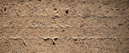 Sand texture photography. Dirt road, graphic resources and wallpaper. Close up image on natural soil Foto de archivo