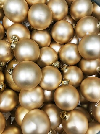 Nice golden christmas toys in box. Top view.