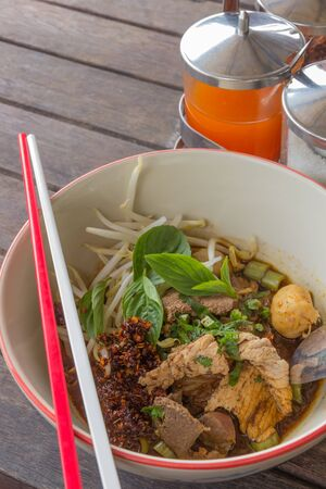 Wide rice noodle  soup with vegetables and meat Stock Photo