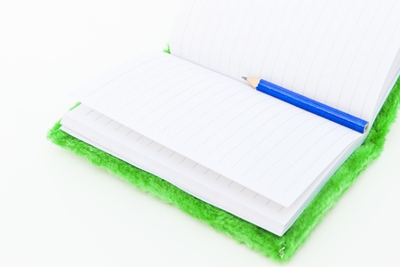 velvet Notebook and Pencil on white background