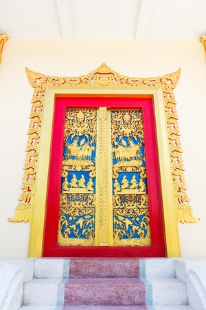 Thai style carved door in thailand photo