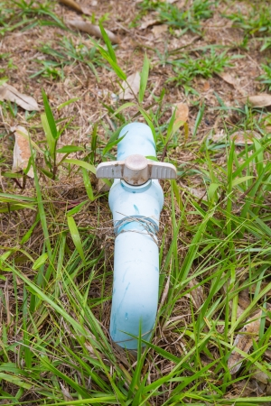 the blue pvc pipe connection with valve. photo