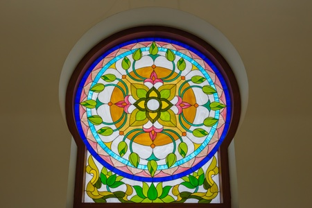 Antique Stained Glass in Sanctuary in thailand Stock Photo