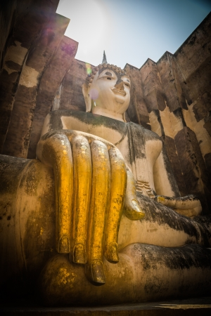 Buddha with golden hand in the temple of Sukhothai Editorial