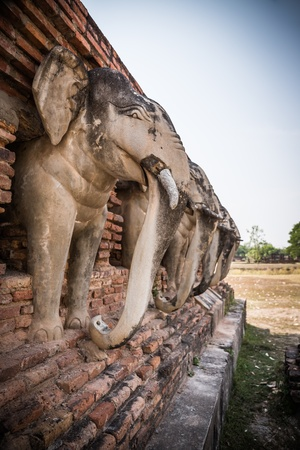 elephant statue around pagoda at temple  Wat Chang Lom , Sukhothai, Thailand