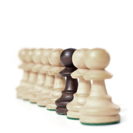 chess game. white prawns in a row with black one. exclusivity concept.  Banque d'images