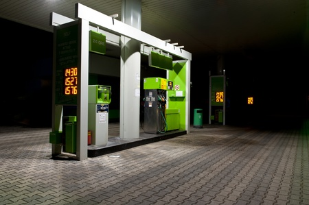 fossil fuels: gas station at night. Stock Photo