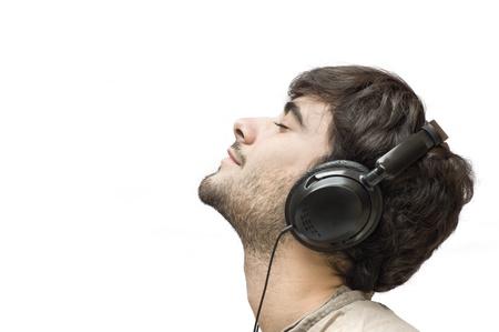 Profiel van een man met oor-telefoons op wit wordt geïsoleerd Stockfoto