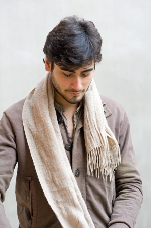 Portrait of casual man wearing scarf   photo