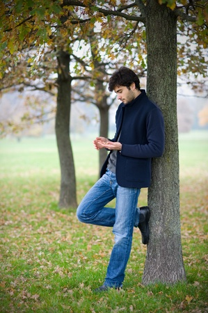 Intimate portrait of man outside in a park Stock Photo - 17504689