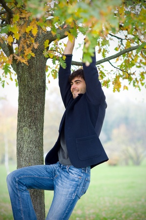 Man having fun outside in a park   photo