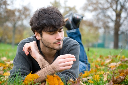 Intimate portrait of man outside in a park Stock Photo - 17504687