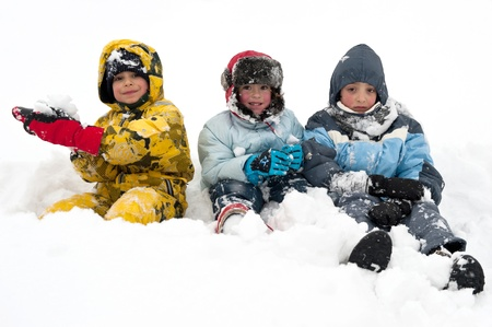Young kids playing in the snow