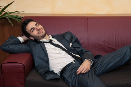 Tired young businessman relaxing on sofa   Stock Photo - 17505712