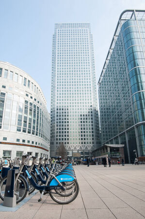 LONDON - APRIL 10, 2014: Barclays Cycle Hire in Canary Wharf. Barclays Cycle Hire (BCH) is a public bicycle sharing scheme in London, currently with 8,000 cycles and 570 docking station.