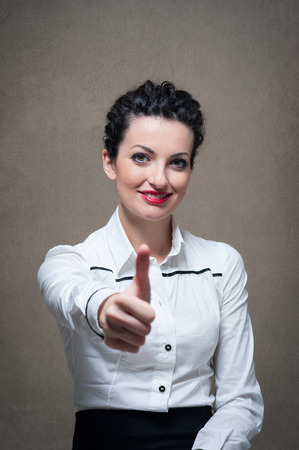 Business woman portrait with thumbs up on grunge background  Stock Photo
