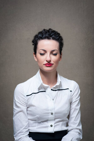 Business woman portrait with closed eyes on grunge background