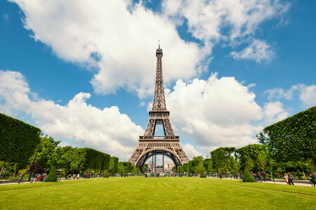 Eiffel Tower and gardens isolated against blue cloudy sky  Paris, France   photo