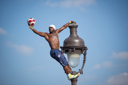 PARIS, FRANCE - MAY 15, 2014  Fantastic ball performance by Iya Traore at Monmartre Hill  Editorial