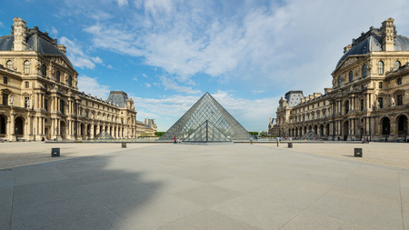 PARIS, FRANCE - MAY 20, 2014  View of the Louvre Museum and the Pyramid at daytime