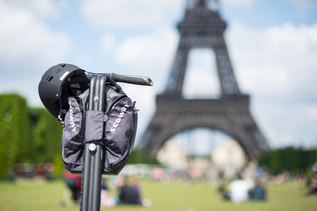 PARIS, FRANCE - MAY 14, 2014  Segway parked in front the Eiffel Tower in Paris