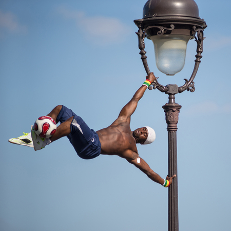 PARIS, FRANCE - MAY 15, 2014  Fantastic ball performance by Iya Traore at Monmartre Hill