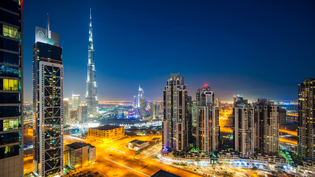 DUBAI, UAE - MARCH 28, 2014  Panoramic view of Burj Khalifa tower at night, the tallest man-made structure in the world, at 829 8 m  2,722 ft    Editorial