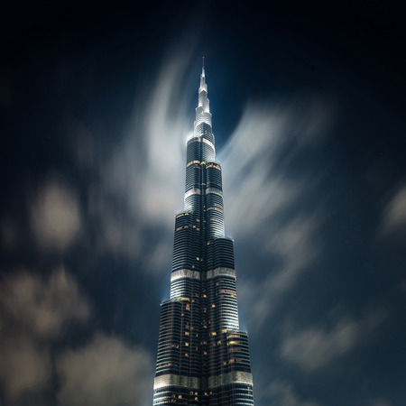 DUBAI, UAE - MARCH 28, 2014  View of Burj Khalifa tower at night with clouds  Long exposure photo