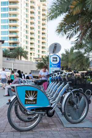 persian gulf: DUBAI, UAE - MARCH 27, 2014: A bike rental of Dubai Marina. Dubai Marina is an artificial 3 km canal carved along the Persian Gulf shoreline.