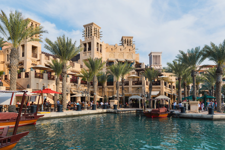 encompasses: DUBAI, UAE - MARCH 29, 2014: View of the Souk Madinat Jumeirah. Madinat Jumeirah encompasses two hotels and clusters of 29 traditional Arabic houses.