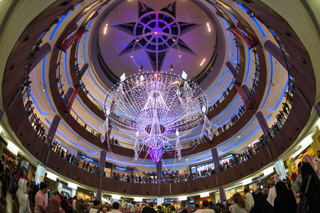 DUBAI, UAE - MARCH 29 2014: People walking inside Dubai Mall. At over 12 million sq ft, it is the worlds largest shopping mall.  Editorial