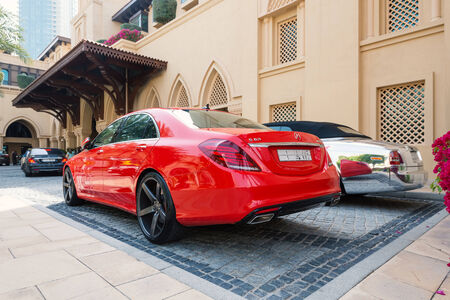 DUBAI, UAE - MARCH 30, 2014: Luxury car parked outside Palace Hotel. In Dubai there is a high concentration of luxury cars due to the high pro capital income.