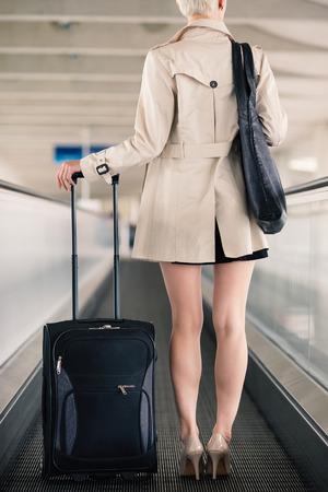 charles de gaulle: Businesswoman portrait with trolley at Charles de Gaulle airport, Paris.