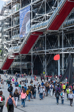 PARIS, FRANCE - MAY 16, 2014: Tourists walking in front of the Centre Georges Pompidou. The structure was completed in 1977 and is one of most recognizable landmarks in Paris.