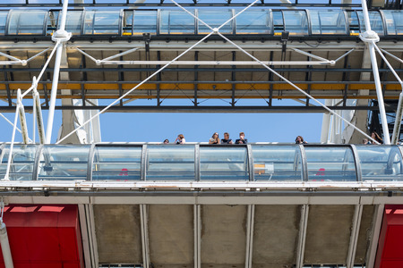 PARIS, FRANCE - MAY 16, 2014: Tourists inside the Centre Georges Pompidou. The structure was completed in 1977 and is one of most recognizable landmarks in Paris. Éditoriale
