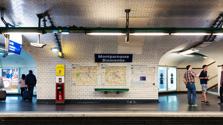 PARIS, FRANCE - MAY 17, 2014: Montparnasse Metro Station. The Paris Metro is a rapid transit system in the Metropolitan Area. It is mostly underground (214 kilometres) and has 303 stations.  Éditoriale
