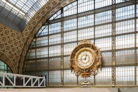 PARIS, FRANCE - MAY 17, 2014: Musee dOrsay Clock by Victor Laloux. Opened in 1986, the museum houses the largest collection of impressionist and post-impressionist masterpieces in the world.