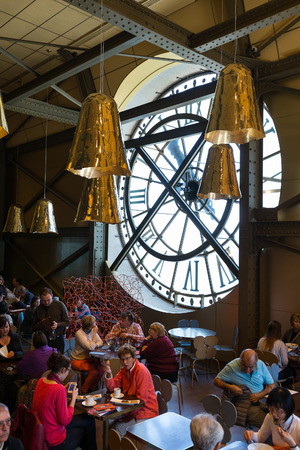 PARIS, FRANCE - MAY 17, 2014: Visitors inthe Cafeteria of the Musee dOrsay. Opened in 1986, it houses the largest collection of impressionist and post-impressionist masterpieces in the world.