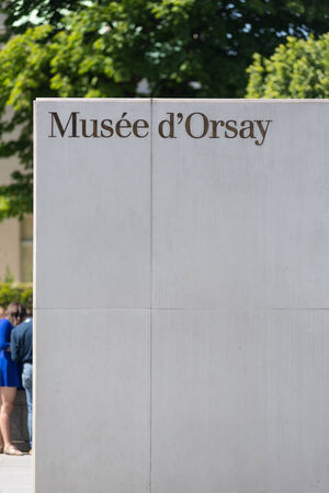 PARIS, FRANCE - MAY 17, 2014: Entrance of the Musee dOrsay. Opened in 1986, it houses the largest collection of impressionist and post-impressionist masterpieces in the world. Editorial