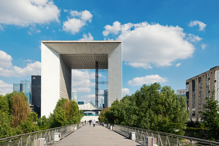 PARIS, FRANCE - MAY 18, 2014: La Grande Arche at daytime. The Arche is in the approximate shape of a cube (110mt) and was inaugurated in July 1989, for the bicentennial of the French revolution.  Editorial