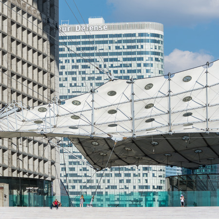 approximate: PARIS, FRANCE - MAY 18, 2014: La Grande Arche at daytime. The Arche is in the approximate shape of a cube (110mt) and was inaugurated in July 1989, for the bicentennial of the French revolution.  Editorial