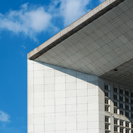 PARIS, FRANCE - MAY 18, 2014: La Grande Arche at daytime. The Arche is in the approximate shape of a cube (110mt) and was inaugurated in July 1989, for the bicentennial of the French revolution.  Éditoriale