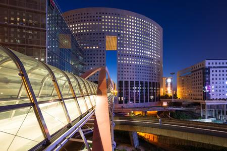 PARIS, FRANCE - MAY 18, 2014: Night view of La Defense quartier, a major business district of Paris. La Defense welcomes 8.4 million visitors each year.  Editorial