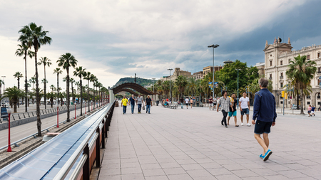 BARCELONA, SPAIN - MAY 31, 2014: People walking on Passeig de Colom. Éditoriale